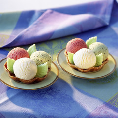 scoops of ice cream in tulip wafer cases