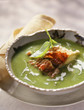 Cream of pea soup with crisp diced bacon