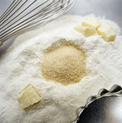 flour, sugar, butter, baking tray and whisk