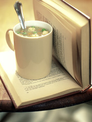 Cup of soup and a book