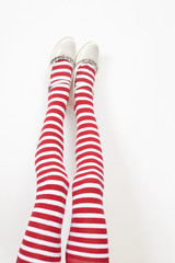 girl`s legs wearing white and red stokings