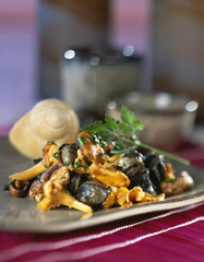 Pan-fried snails and chanterelles