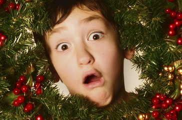 Boy In A Christmas Wreath
