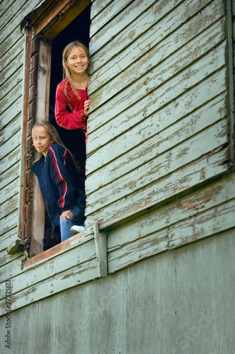 Girls Looking Out Of A Barn