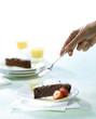 sprinkling chocolate cake with icing sugar