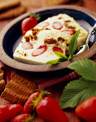 mascarpone cream dessert with strawberries and  gingernut biscuits