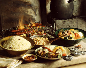 Couscous with brochettes cooking on wood fire