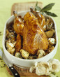 Guinea-fowl with ceps and garlic