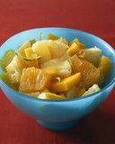 Pineapple,orange,mango and lime fruit salad