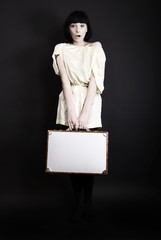 A girl with suitcase