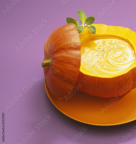 Pumpkin soup served in the pumpkin