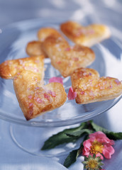 Heart-shaped biscuits covered with pink sugar