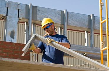 Worker Bending Metal