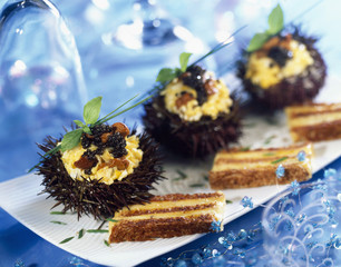scrambled eggs with caviar in sea urchin shell