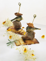 Lamb,artichoke and mushroom brochettes