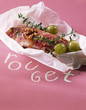 Red mullet with thyme and grapes cooked in wax paper