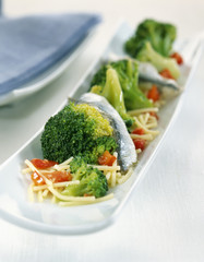 Chinese noodles with anchovies and vegetable salad