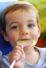 Young boy licking a lollipop