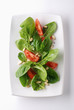 Spinach salad with tomatoes and pine nuts