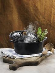 Cast iron casserole dish and steam