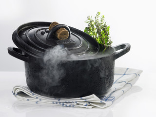 Cast iron casserole dish with steam