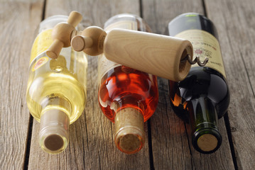 Assorted bottles of wine and corkskrew