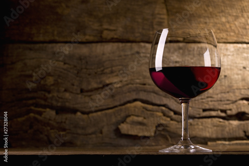 Glass of red wine in the cellar
