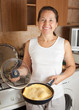 woman with  omelette in skillet. Cooking  omelet  see in series