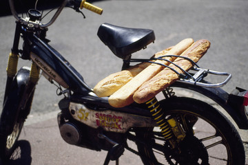 scooter carrying bread