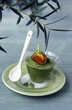 Verrine of cream of courgette and a leaf full of lumpfish roe