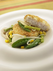 Breaded cod with green vegetables