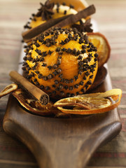 Fresh orange decorated with cloves