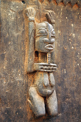 Traditional Dogon carved figure on a door