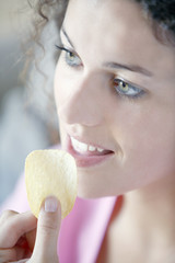 Woman eating a chip