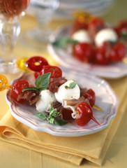Cherry tomato,feta and raw ham brochettes