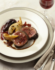 Beef fillet en chevreuil with roast figs and pears