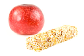 Muesli snack stick and plum