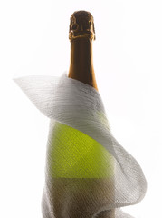 Bottle of champagne wrapped in light cloth