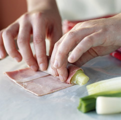Wrapping the leek with boiled ham