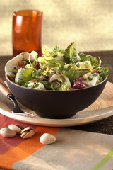 Mixed salad with pistachios and almonds
