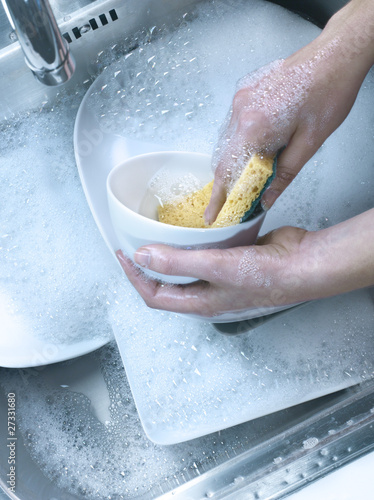 Washing the dishes in the sink