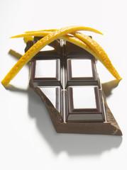 Squares of dark chocolate and orange zests