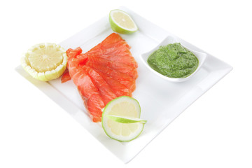 green sauce and salmon with lemon