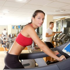 Gym treadmill running young woman interior