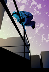 A young man is jumping over the metal railing