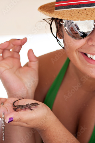 Woman Holding a Tropical Lizard
