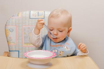 baby eating breakfast