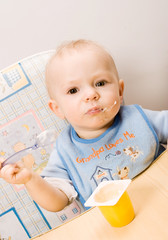 baby eating yoghurt