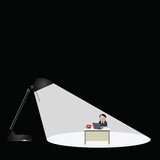 Desk lamp spotlighting worker sat at desk