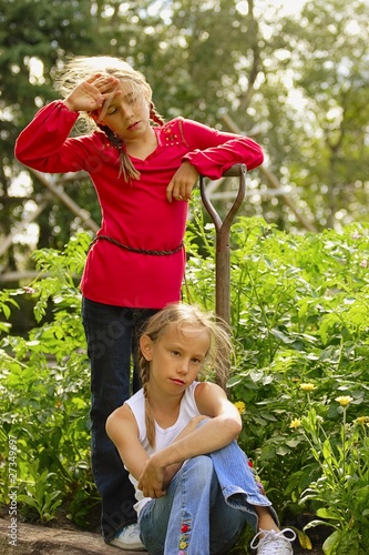 Two Girls Resting From Garden Work